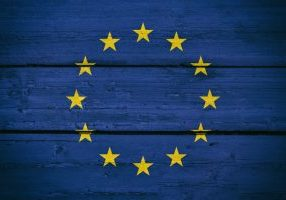 Bright Europe National Flag on a Wooden Background.